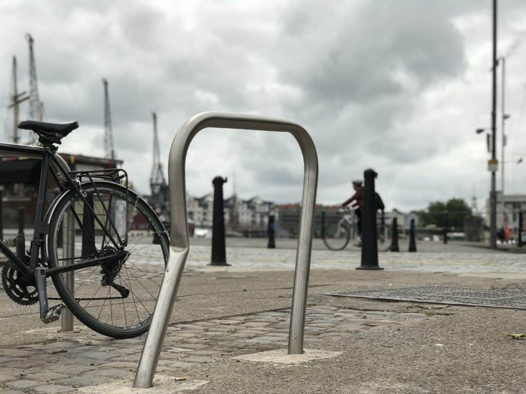 A bike rail that has been damaged
