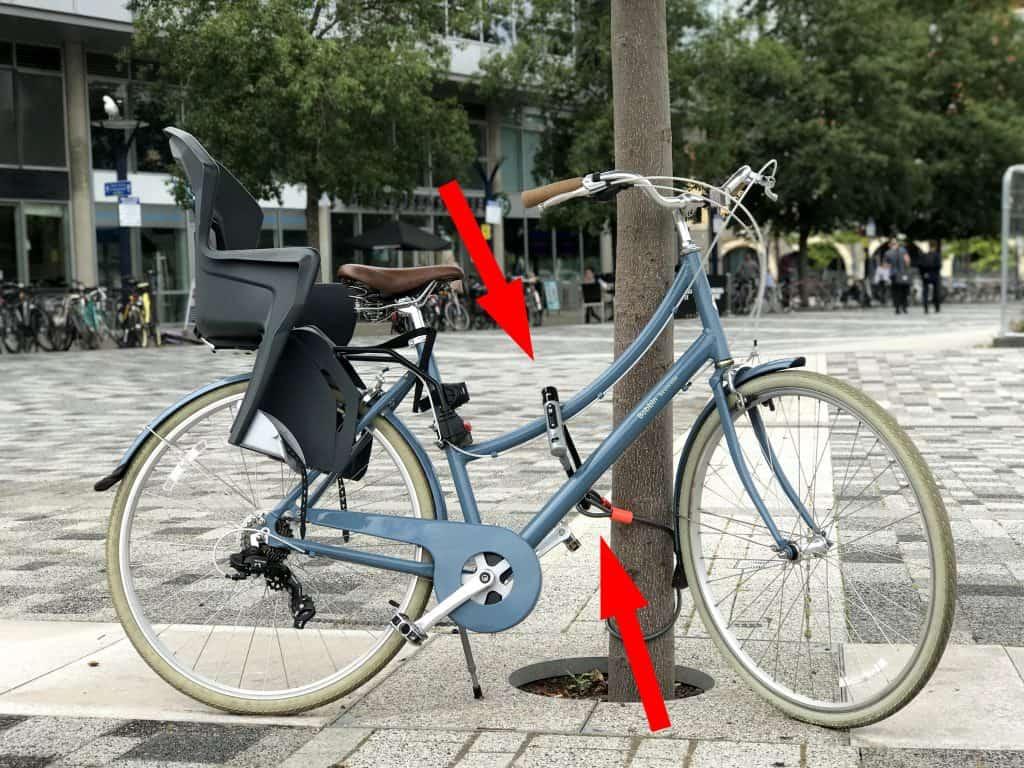 Poorly secured bicycle bike secured to tree