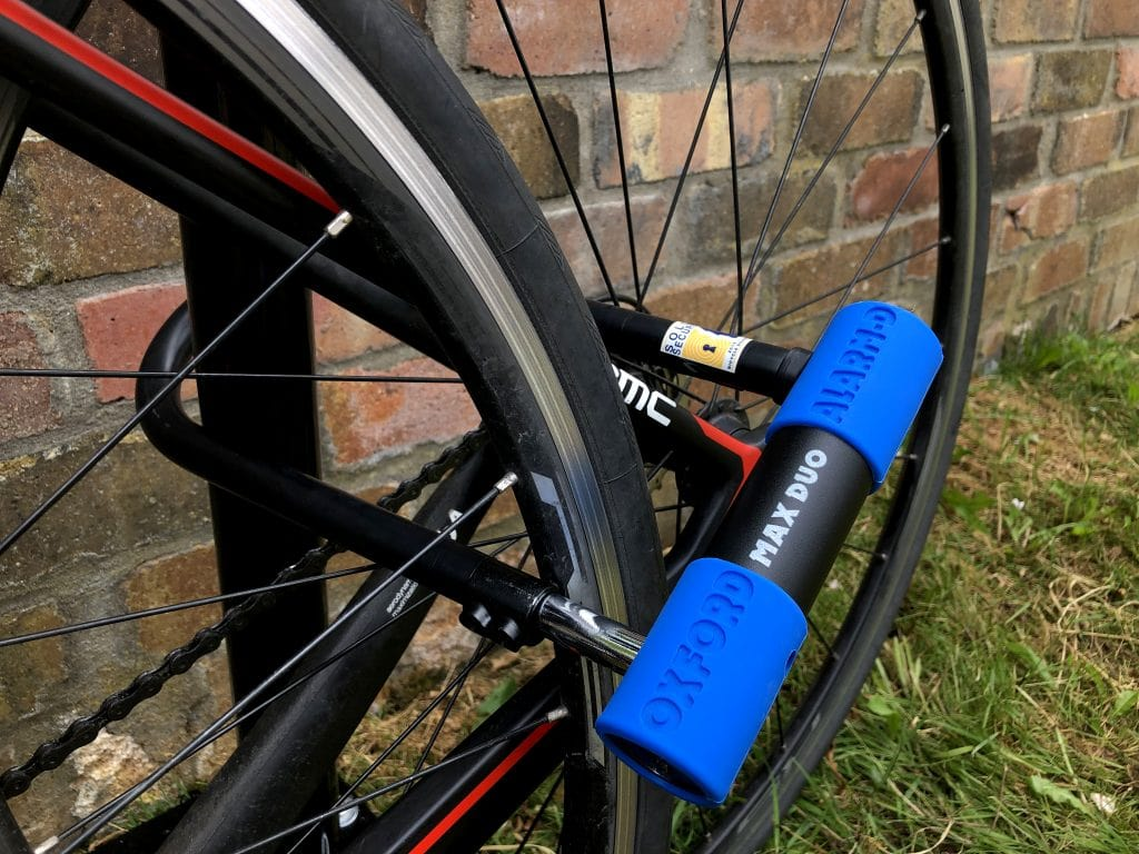 Both wheel and frame of bike secured using oxford alarm max duo