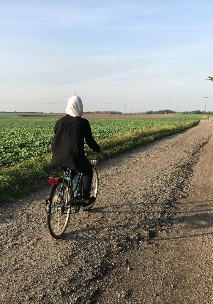 Hybrid bike being ridden on a gravel path
