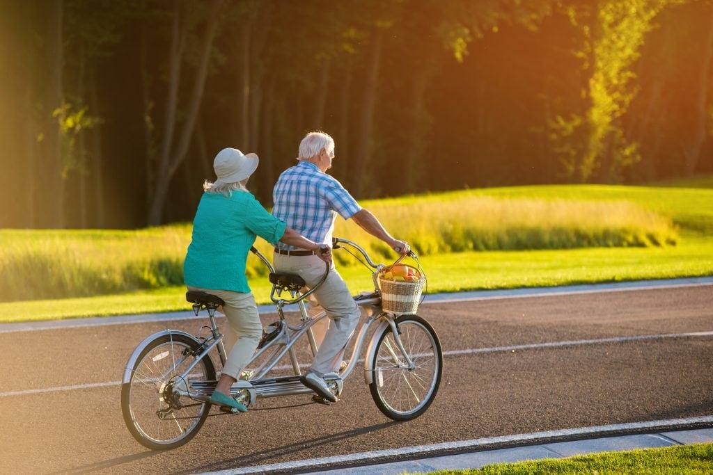 Tandem bike being ridden by a senior couple