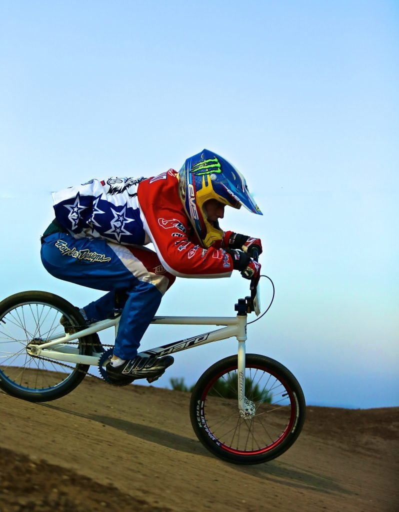 BMX racer wearing a full-face helmet