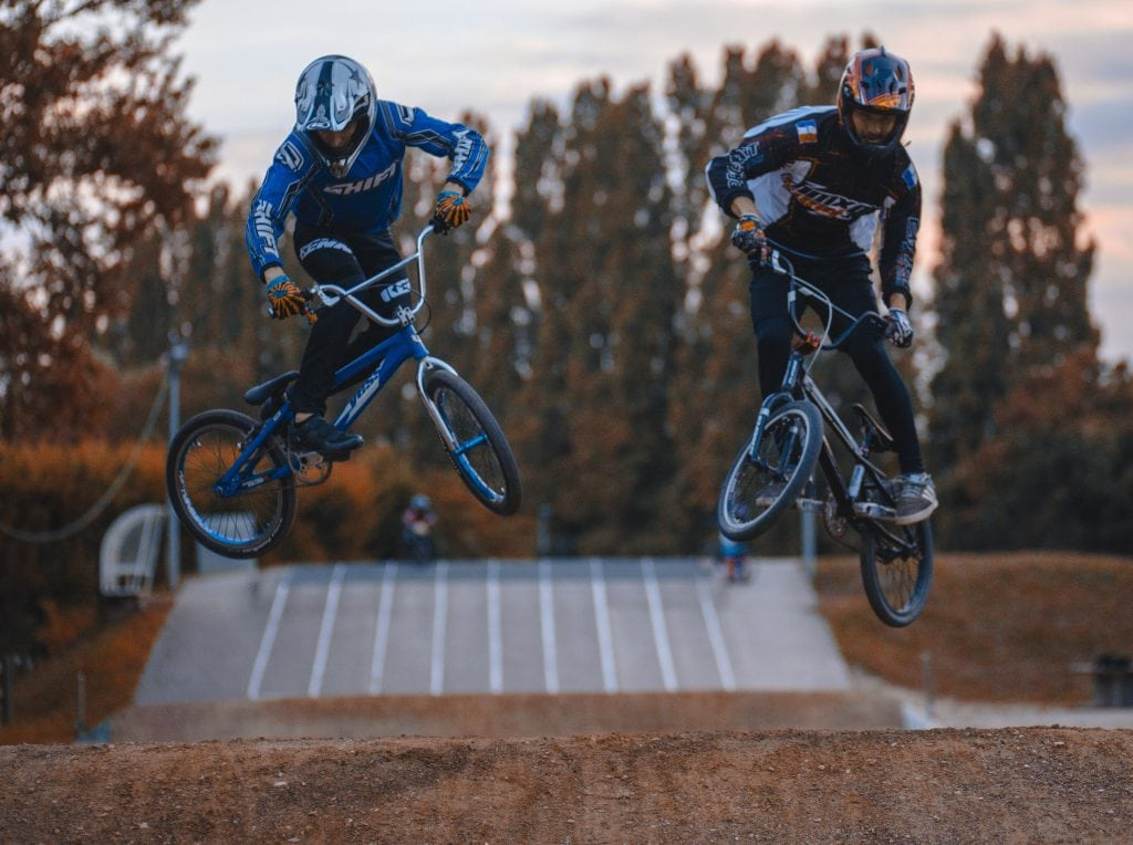 BMX Racing, two individuals compete on a BMX racetrack