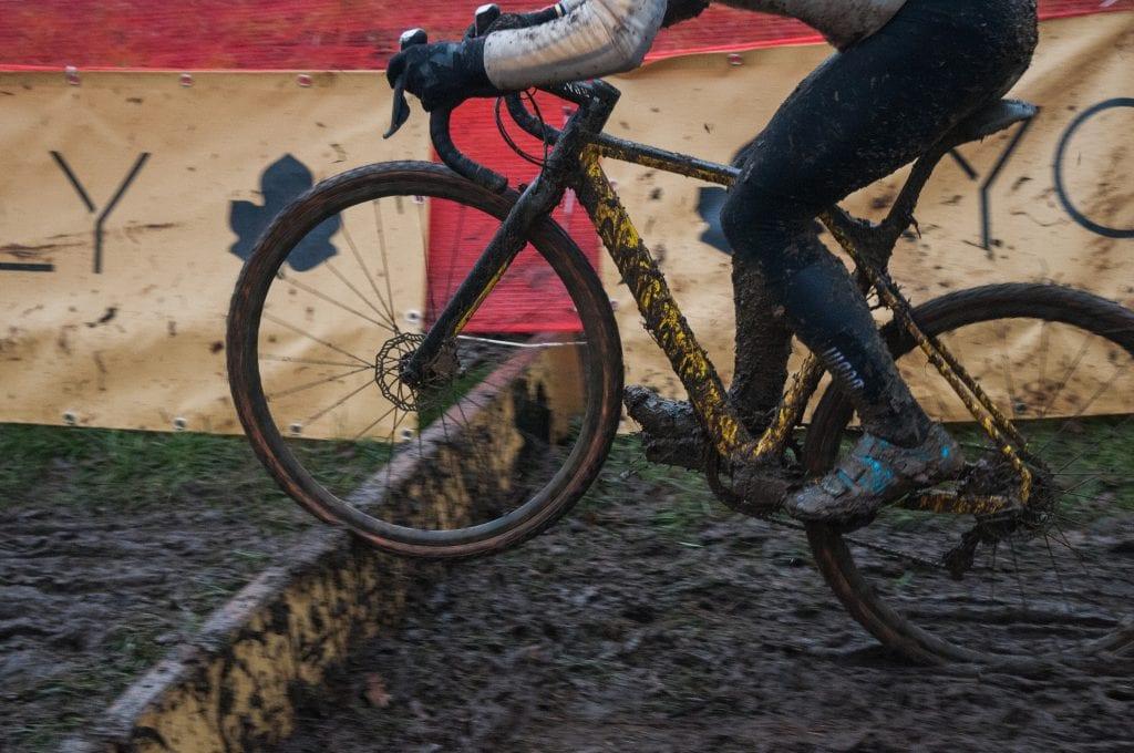 cyclocross bike jumping barrier in race