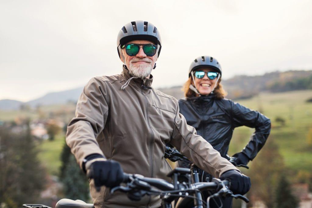 elderly couple riding e bikes together
