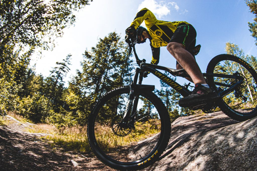 27.5 inch mountain bike riding on rocky trail