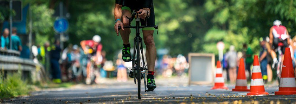 man racing in triathlon event on a triathlon bike