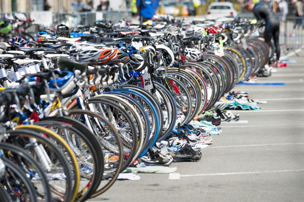 row of triathlon bikes being used in a competition