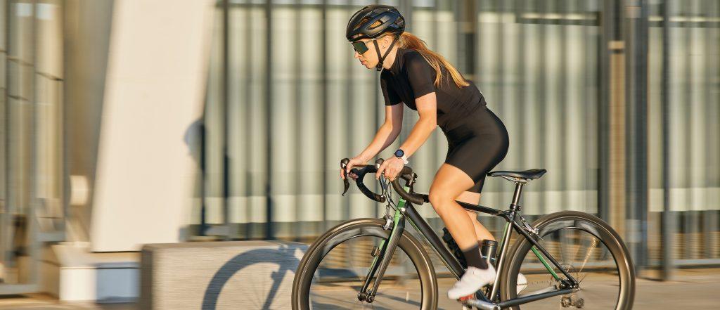 female cyclist riding a road bike in lycra