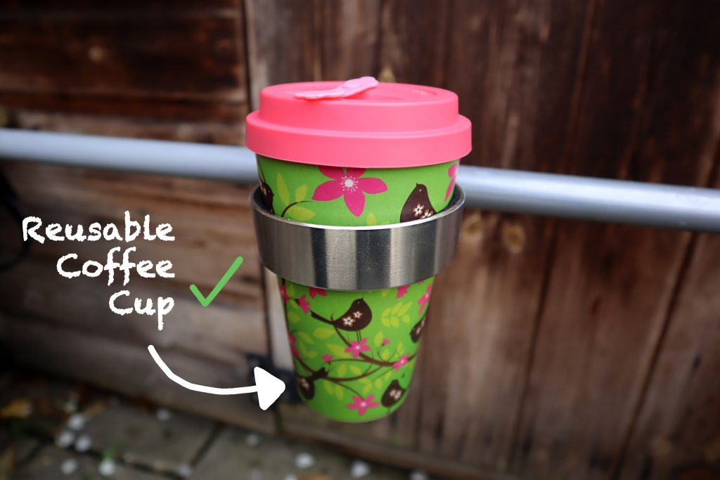 bike coffee cup holder with reusable coffee cup