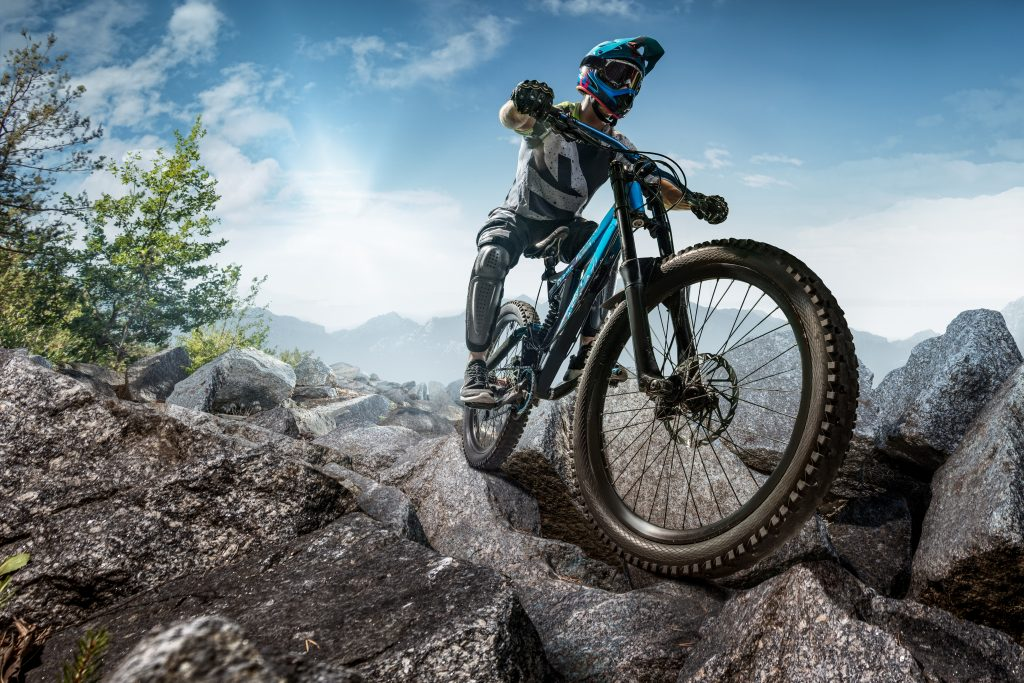 Downhill cycling on bumpy trail