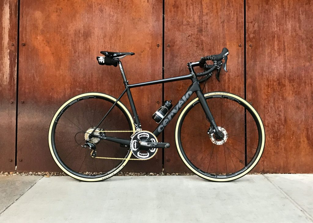 a road bicycle bike standing against a wall