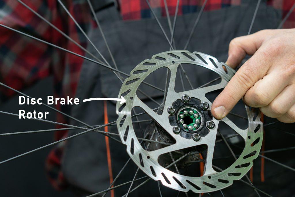 installing a new disc brake rotor on a bike